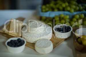 Variety of cheese and blue berry on counter