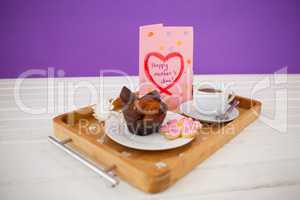 Happy mothers day greeting card with tea and snacks
