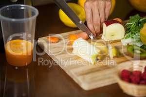 Staff chopping carrot at counter