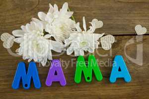 Heart shape with alphabet reading mama and white flowers