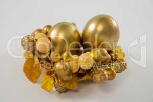 Golden Easter eggs in decorated basket
