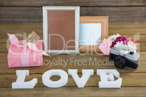 Gift box, photo frame, vintage camera and flower vase