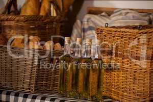 Sesame oil and bread in wicker basket