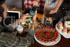 Customer making payment through credit card at counter