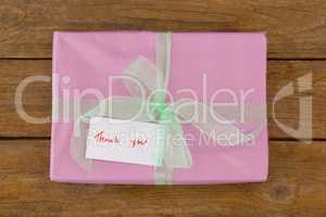 Thank you card with gift box on table