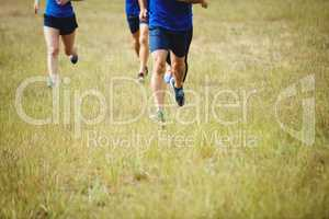 Fit people running in boot camp