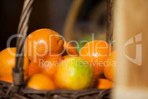 Juicy oranges in wicker basket at organic section