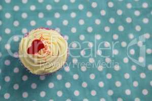 Cupcake against polka dot background