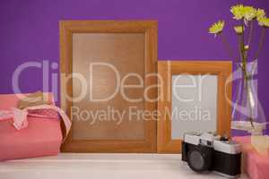Happy mothers day card on gift box with wooden frames and camera
