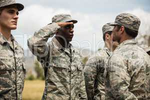 Military trainer giving training to military soldier