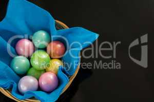 Colorful chocolate Easter eggs in napkin