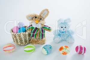 Basket with Easter eggs and toy Easter bunny