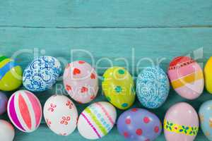 Painted Easter eggs on wooden plank