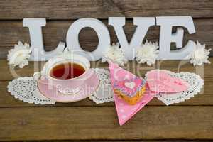 Cookies, tea, flowers and happy mothers day card with love text