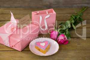 Gift box with roses and heart shape cookies