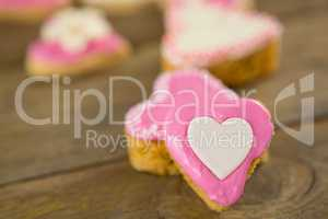 Heart shape cookies on wooden plank