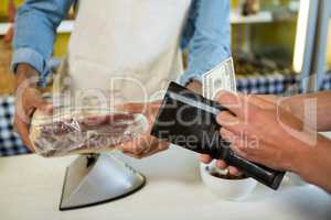 Staff receiving payment from the customer