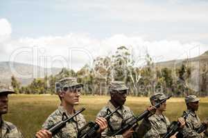 Group of military soldiers standing with rifles