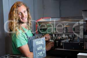 Barista preparing coffee in coffee machine