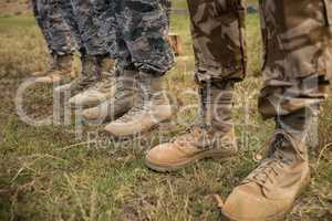Low-section of military soldiers standing in line