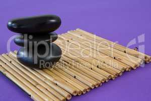 Zen stones on bamboo mat