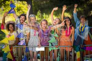 Group of friends dancing at music festival