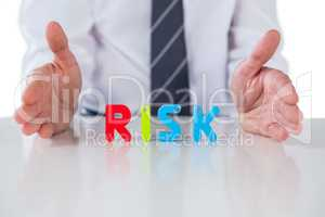 Businessman showing a word RISK