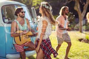 Group of friends having fun in music festival