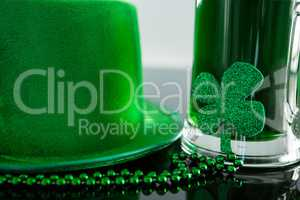 St Patricks Day green beer with shamrock, leprechaun hat and bead