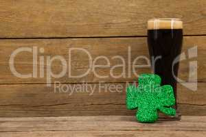 Glass of black beer and shamrock for St Patricks Day