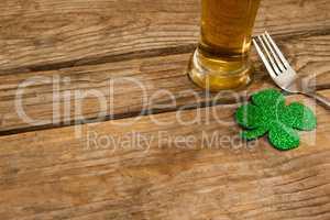 Glass of beer, fork and shamrock for St Patricks Day