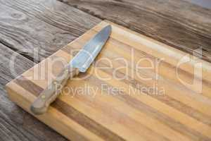 Knife on wooden tray