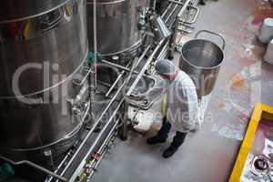 Factory engineer monitoring storage tank