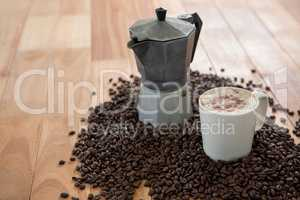Coffeemaker with coffee beans and coffee mug