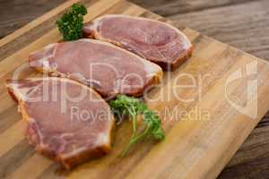 Blade chop and coriander leaves on wooden tray