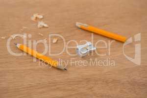 Broken yellow pencil with sharpener