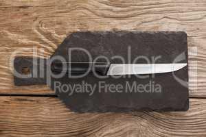 Knife on black slate plate