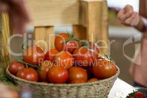 Basket of fresh tomatoes on the counter