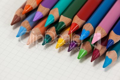 Close-up of colored pencils arranged in a row