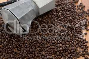 Coffee beans with metallic coffeemaker