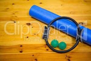Exercise equipment kept on wooden floor