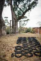 Boot camp with tyres obstacle course and fitness trial