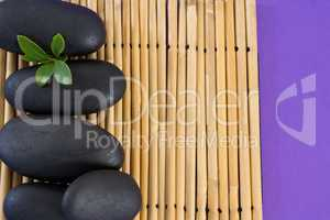 Stones with leaf kept on bamboo mat