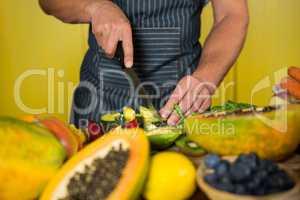 Staff chopping avocado at counter