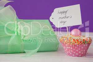 Happy mothers day card with cup cake and gift box