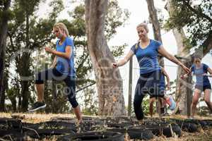 Women receiving tire obstacle course training