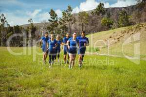 Fit people jogging in boot camp