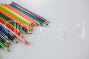Colored pencils arranged in a wavy pattern