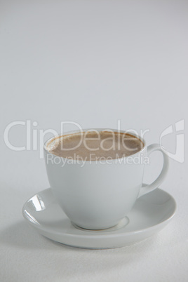 White cup of coffee with froth with creamy froth