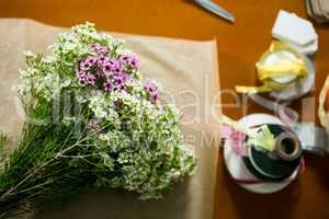 Flowers on the wooden worktop at flower shop